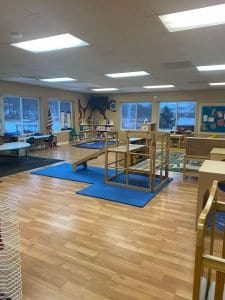 daycare room with wooden playstructures