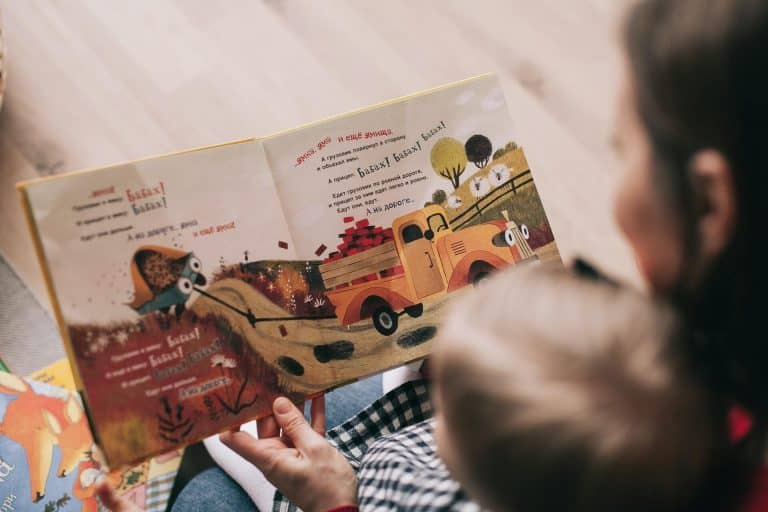 woman reading young child a book
